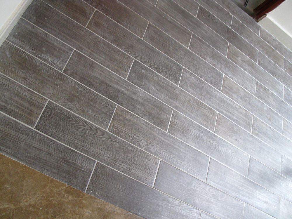 看看我家入户花园瓷砖填了缝的样子 老公选的木纹砖,效果还